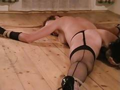 After spanking my arse hardly my Master was so kind and played with my pussy for a while He irritated my clit while fingering my arse and pussy After that he forced me to huge orgasm using a giant dildo which he previously fixed to a bamboo stick