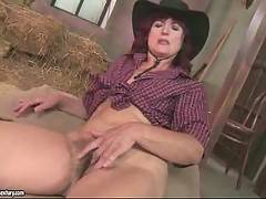Nasty farmer granny touches herself in barn and gets more and more horny.