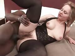 Muscled black guy deeply penetrates mature white slut.