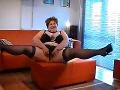 My new 4 part film In part 1 Im wearing new stockings high heels plus a matching lingerie set of full 44g bra knickers and suspender belt Watch as I dance and show off my big flabby belly for you