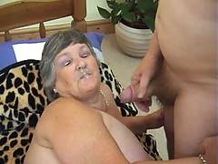 Riding reverse cowgirl on a stiff cock and having my tits fondled by another guy  this grandma is having a wild time Finally I take a big load of hot thick white sticky cum all over my face  Thats both the guys satisfied for the time being and Greedy Gran