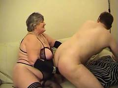 Grandma spanks Dannys bare ass as he kneels in front of me I caress his hanging balls with my velvet gloved hand and when he could stand no more he turned me over  to thrust his hard member into my wet juicy cunt